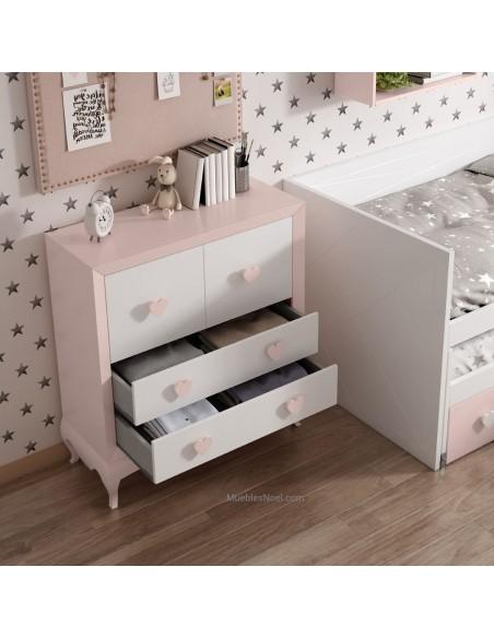 Cómoda de dormitorio juvenil blanco y rosa.