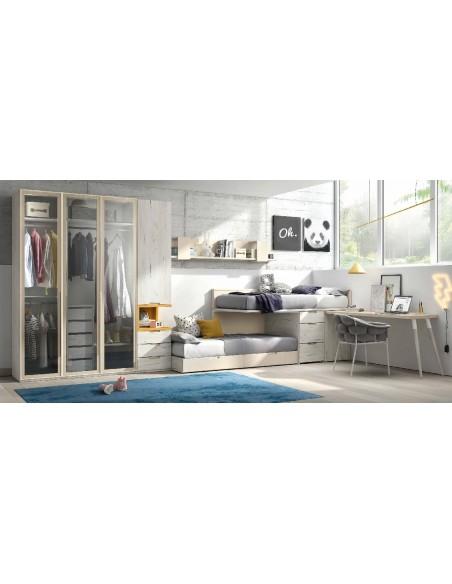 Dormitorio juvenil con una litera tipo tren con cama baja deslizante, cajones que sirven de escalera y mesa estudio integrada.